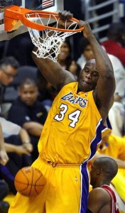 Shaquille O'Neal earned an NBA record $292 million over a 20-year career. His first three owners are worth more than $11 billion. (Photo courtesy Los Angeles Times).