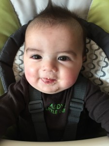 Trying to get solid food into this guy typically results in as much food on his face as in his belly.