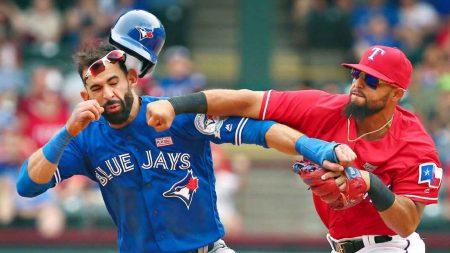 Texas Rangers 2B Rougned Odor decks Toronto Blue Jays OF Jose Bautista.